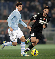 Calcio, semifinale di ritorno di Coppa Italia: Lazio vs Juventus. Roma, stadio Olimpico, 29 gennaio 2013..Lazio midfielder Hernanes, of Brazil, is challenged by Juventus forward Mirko Vucinic, of Montenegro, during the Italy Cup football semifinal return leg match between Lazio and Juventus at Rome's Olympic stadium, 29 January 2013..UPDATE IMAGES PRESS/Riccardo De Luca