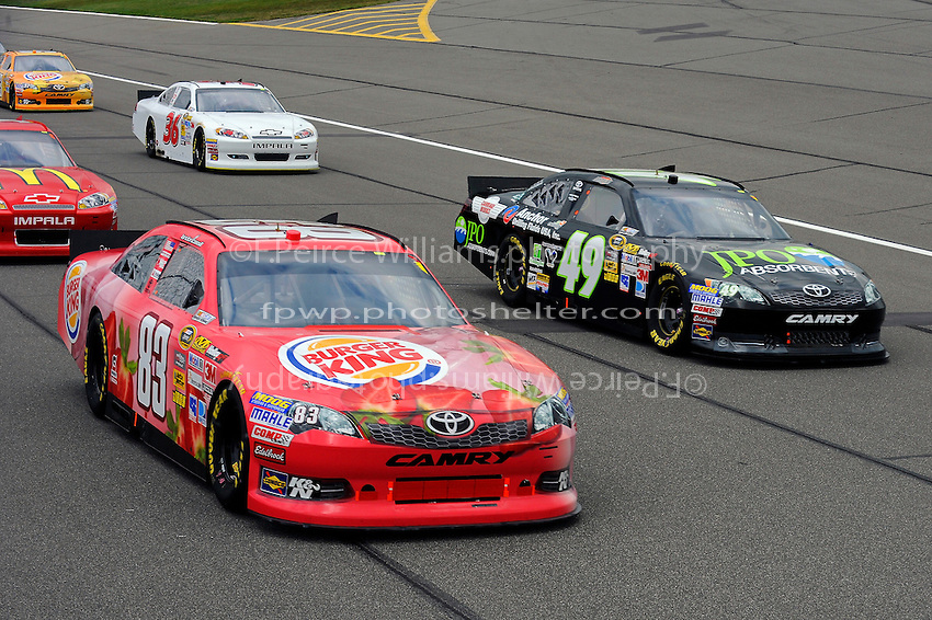 Landon Cassill, (#83) Burger King/Dr. Pepper Camry and J.J. Yeley, (#49) JPO Absorbents Camry