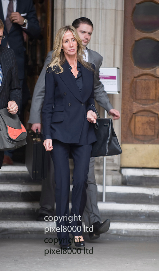 Michelle Young  leaves the High Court where she contesting a multi million pound divorce case against<br /> Scott Young<br /> <br /> <br /> <br /> Picture by Gavin Rodgers/ Pixel 07917221968