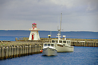 Lighthouse, wharf and boats<br /> Belliveau Cove<br /> Nova Scotia<br /> Canada