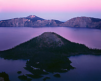ORCL_068 - USA, Oregon, Crater Lake National Park, View eastward reveals glow of evening twilight sky over Crater Lake with nearby Wizard Island and distant Mount Scott.