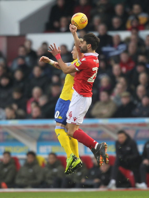 Leeds United's Ezgjan Alioski jumps with Nottingham Forest's Claudio Yacob<br /> <br /> Photographer Mick Walker/CameraSport<br /> <br /> The EFL Sky Bet Championship - Nottingham Forest v Leeds United - Tuesday 1st January 2019 - The City Ground - Nottingham<br /> <br /> World Copyright © 2019 CameraSport. All rights reserved. 43 Linden Ave. Countesthorpe. Leicester. England. LE8 5PG - Tel: +44 (0) 116 277 4147 - admin@camerasport.com - www.camerasport.com