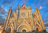 14th century Tuscan Gothic style facade of the Cathedral of Orvieto at sunset, designed by Maitani, Umbria, Italy
