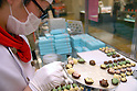 "A pastry chef makes chocolates at Nihonbashi Takashimaya's chocolate fair ""Amour du Chocolat!"" for Valentine's Day in Tokyo."