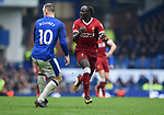 Sadio Mane of Liverpool is challenged by Wayne Rooney of Everton during the premier league match at Goodison Park Stadium, Liverpool. Picture date 7th April 2018. Picture credit should read: Robin Parker/Sportimage