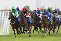 Dramatic Duke (2) ridden by A P McCoy leads the field in the Frimstone Standard Open National Hunt Flat Race