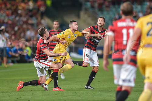 01.04.2016. Pirtek Stadium, Parramatta, Australia. Hyundai A-League. Western Sydney Wanderers versus Central Coast Mariners. Mariners forward Roy O'Donovan holds off the tackles from Wanderers defenders as a cross comes in. The Wanderers won 4-1.