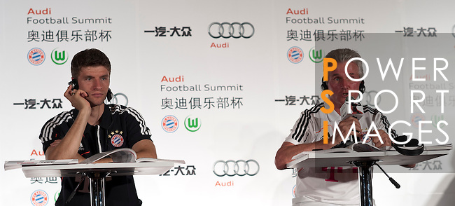 GUANGZHOU, GUANGDONG - JULY 26:  Thomas Muller and head coach Jupp Heynckes of Bayern Munich attends a press conference ahead the friendly match against VfL Wolfsburg as part of the Audi Football Summit 2012 on July 26, 2012 at the Westin hotel in Guangzhou, China. Photo by Victor Fraile / The Power of Sport Images