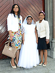 Nneka Ezeani from St Mary's National school who received first holy communion at St Mary's church pictured with mam Sophie and sister Angel. Photo: Colin Bell/pressphotos.ie