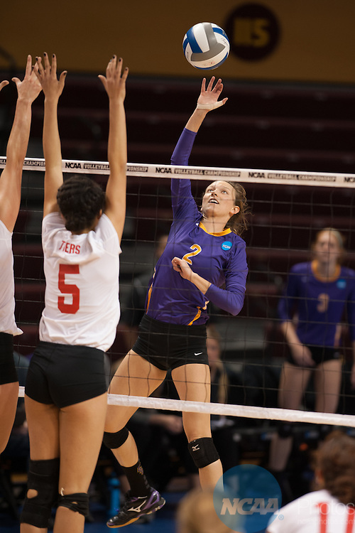 21 NOV 2015: Cal Lutheran's Allie Eason spikes the ball past Wittenberg's Kendall Farmer during the Division III Women's Volleyball Championship held at Van Noord Arena on the Calvin University campus in Grand Rapids, MI. Cal Lutheran defeated Wittenberg 3-0 for the national title. Erik Holladay/NCAA Photos