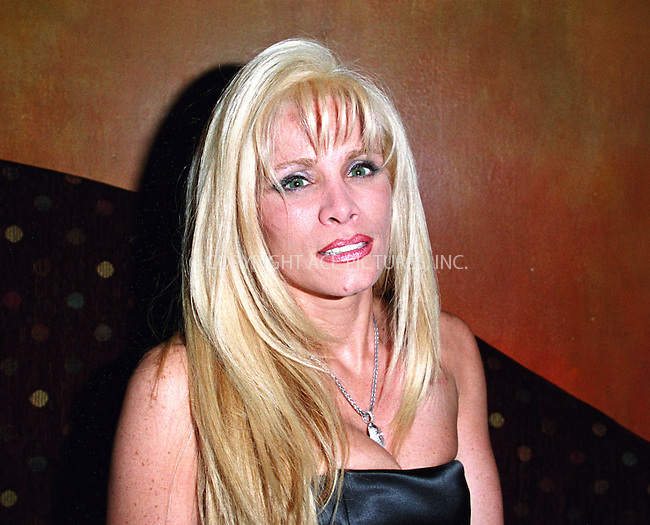 """VICTORIA GOTTI, who is the 38-year-old daughter of imprisoned mafia boss John Gotti, underwent emergency open-heart surgery Thursday night after being stricken with chest pain at her home in Old Westbury, Long Island, The Daily News reports. Surgeons told Gotti that her heart had been damaged by her pacemaker, which went out of order last November as the result of interferance from an electronic exercise machine Gotti wore to tighten her abdominal muscles. Gotti's spokesman said that Gotti is in considerable pain and that the prognosis is good. Victoria Gotti needs the pacemaker because she suffers from a heart condition known as mitral velve prolapse. Victoria Gotti, a law school graduate and the author of five novels, is the New York Post columnist and the correspondent on the syndicated entertainment TV show """"Extra."""" April 14, 2002...Please byline: Alecsey Boldeskul/NY Photo Press.   ..*PAY-PER-USE*      ....NY Photo Press:  ..phone (646) 267-6913;   ..e-mail: info@nyphotopress.com"""