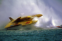"The Grand Prix Hydroplane ""Wild Fire"" ( # GP-12 ) driven by George Stratton dives through the roostertail of another boat and begins to flip over. The boat would do a 360 degree barrel-roll and come to rest upright with the hull and driver in fine conditition...© F. Peirce Williams 1998"