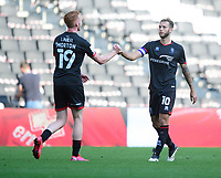Lincoln City's Callum Morton, left, celebrates the victory with Jorge Grant<br /> <br /> Photographer Chris Vaughan/CameraSport<br /> <br /> The EFL Sky Bet League One - Milton Keynes Dons v Lincoln City - Saturday 19th September 2020 - Stadium MK - Milton Keynes<br /> <br /> World Copyright © 2020 CameraSport. All rights reserved. 43 Linden Ave. Countesthorpe. Leicester. England. LE8 5PG - Tel: +44 (0) 116 277 4147 - admin@camerasport.com - www.camerasport.com