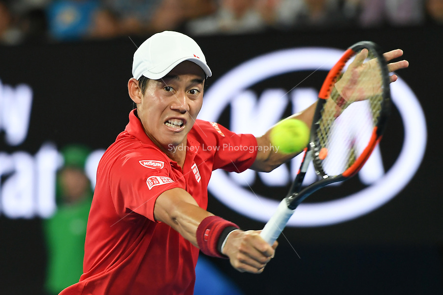 January 22, 2017: Kei Nishikori of Japan in action in a 4th round match against Roger Federer of Switzerland on day seven of the 2017 Australian Open Grand Slam tennis tournament in Melbourne, Australia. Photo Sydney Low