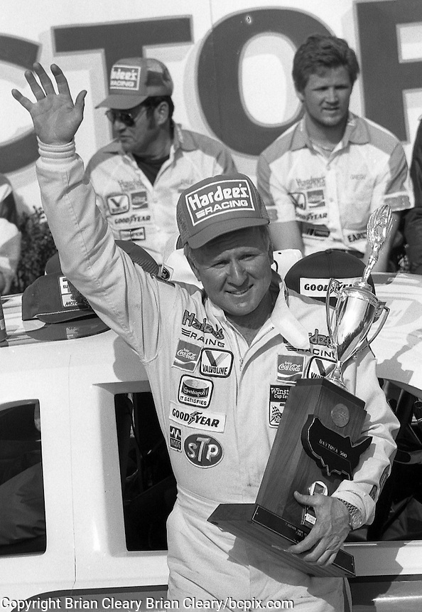 Cale Yarborough victory lane trophy Daytona 500 at Daytona International Speedway in Daytona Beach, FL in February 1985. (Photo by Brian Cleary/www.bcpix.com) Daytona 500, Daytona International Speedway, Daytona Beach, FL, February 1985. (Photo by Brian Cleary/www.bcpix.com)