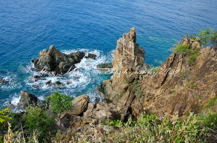 View of the rocky cliffs along the south shore of St. John from the Tektite trail<br /> Virgin Islands National Park<br /> U.S. Virgin Islands