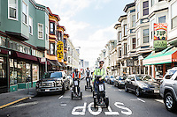 A Segway tour with the San Francisco Electric Tour Company takes you through historic streets in the North Beach neighborhood. San Francisco, California. (pictured: Grant Avenue)