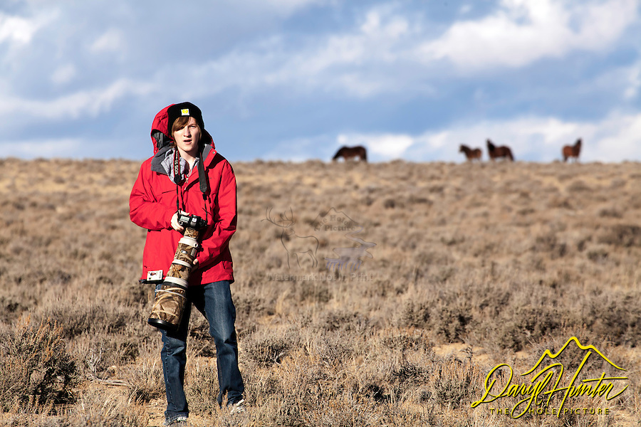 Scott Hunter photographing mustangs in Farson Wyoming