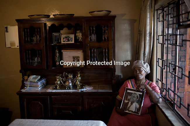 JOHANNESBURG, SOUTH AFRICA - APRIL 14:Mamosadi Catherine Mlangeni, a victim of Apartheid holds a portrait of her killed sonon April 14 2010, in Soweto, South Africa. Khulumanie is involved in the Daimler complaint brought forward by victims of Apartheid. Theplaintiffsargue that Daimler soldvehicles to the old South African government .(Photo by Per-AndersPettersson/Agentur Focus ForSpiegelMagazine)