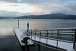 North Idaho College Dock covered with a fresh layer of snow and Lake Coeur D Alene at dawn in December.