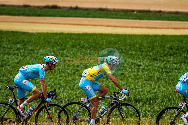 The peleton including race leader YellowJersey Vincenzo Nibali (ITA) Astana pass through rural landscape near Bemont during Stage 4 of the 2014 Tour de France running 163.5km from Le Touquet to Lille. 8th July 2014.<br /> Picture:Thomas van Bracht/Peloton Photos/www.newsfile.ie