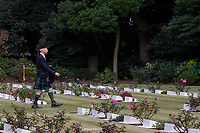 Bagpiper, Frank Hunter at the Remembrance Sunday ceremony at the Hodogaya, Commonwealth War Graves Cemetery in Hodogaya, Yokohama, Kanagawa, Japan. Sunday November 12th 2017. The Hodagaya Cemetery holds the remains of more than 1500 servicemen and women, from the Commonwealth but also from Holland and the United States, who died as prisoners of war or during the Allied occupation of Japan. Each year officials from the British and Commonwealth embassies, the British Legion and the British Chamber of Commerce honour the dead at a ceremony in this beautiful cemetery.