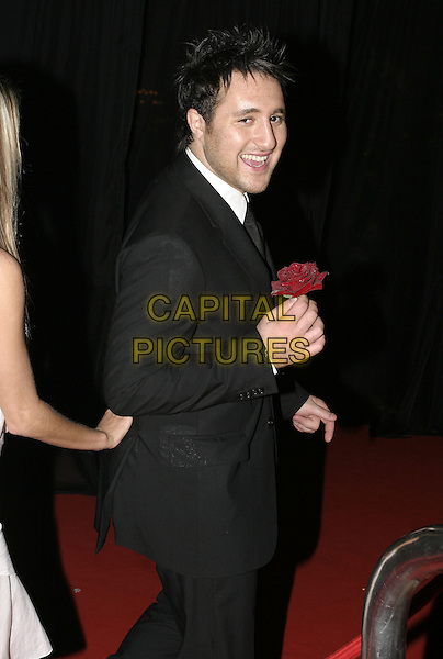 "ANTHONY COSTA.""The Phantom of the Opera"" World Premiere Party,.Grand Hall Olympia, London, December 6th 2004..half length red rose flower.Ref: AH.www.capitalpictures.com.sales@capitalpictures.com.©Capital Pictures."