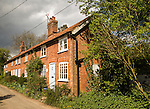 Red brick cottages in Shottisham, Suffolk, England, UK