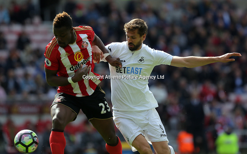 SUNDERLAND, ENGLAND - MAY 13: (L-R) Lamine Kone of Sunderland is challenged by Fernando Llorente of Swansea City during the Premier League match between Sunderland and Swansea City at the Stadium of Light, Sunderland, England, UK. Saturday 13 May 2017