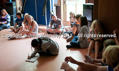 School meeting where children and adults have equal votes, Summerhill School, Leiston, Suffolk. The school was founded by A.S.Neill in 1921 and is run on democratic lines with each person, adult or child, having an equal say.  You don't have to go to lessons if you don't want to but could play all day.  It gets above average GCSE exam results.