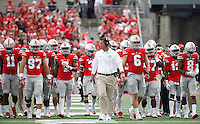Ohio State defensive coordinator and linebacker coach Luke Fickell leads his players during the first quarter of the NCAA football game between the Ohio State Buckeyes and the Tulsa Golden Hurricane at Ohio Stadium on Saturday, September 10, 2016. (Columbus Dispatch photo by Jonathan Quilter)