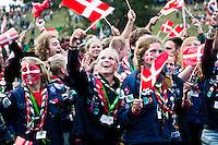 Danish scouts waving their flag. Photo: Fredrik Sahlström/Scouterna
