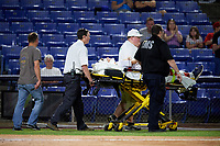 A Binghamton Rumble Ponies player is carted off the field during a game against the Altoona Curve on May 17, 2017 at NYSEG Stadium in Binghamton, New York.  Altoona defeated Binghamton 8-6.  (Mike Janes/Four Seam Images)