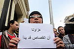 An Egyptian woman holds a placard with Arabic inscription reading 'We are consoled as retribution began' to denounce the killing of Egyptian Christians in Libya, outside the Coptic Cathedral of Saint Marcos, in Cairo, Egypt, 16 February 2015. An Islamic State video released on 15 February claimed to show the extremist group beheading 21 Egyptian Christians abducted in Libya more than a month ago. The Egyptian army responded on 16 February by an airstrike against the militants targeting bases and weapons storage facilities in Libya. Photo by Amr Sayed