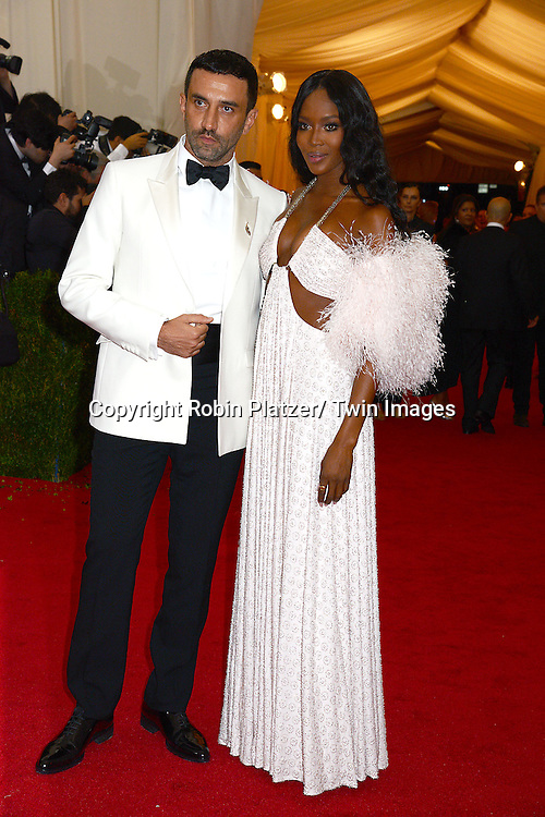 Riccardo Tisci and Naomi Campbell  attends the Costume Institute Benefit on May 5, 2014 at the Metropolitan Museum of Art in New York City, NY, USA. The gala celebrated the opening of Charles James: Beyond Fashion and the new Anna Wintour Costume Center.