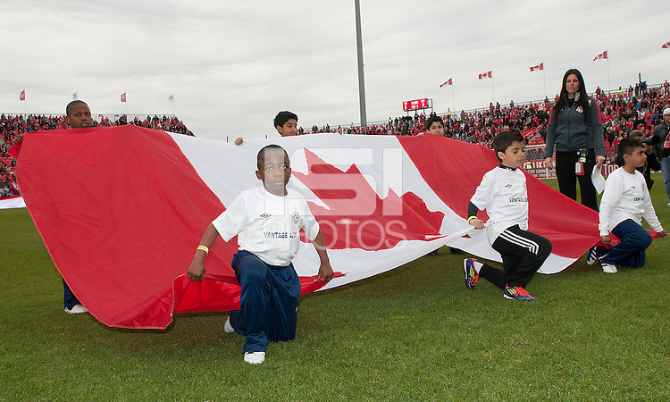 14 April 2012: The kids hold the flag of Canada during the opening ceremonies in a game between Chivas USA and Toronto FC at BMO Field in Toronto..Chivas USA won 1-0..