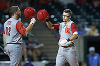 Josh McLain (15) celebrates with Brad Debo (12) of the North Carolina State Wolfpack after a run against the North Carolina Tar Heels in Game Twelve of the 2017 ACC Baseball Championship at Louisville Slugger Field on May 26, 2017 in Louisville, Kentucky. The Tar Heels defeated the Wolfpack 12-4. (Brian Westerholt/Four Seam Images)