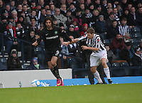 Georgios Samaras being closed down by David van Zanten in the St Mirren v Celtic Scottish Communities League Cup Semi Final match played at Hampden Park, Glasgow on 27.1.13.