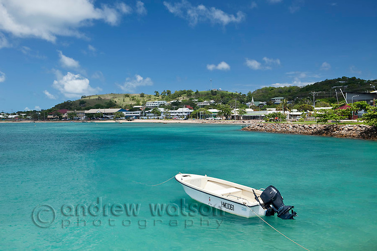 Dinghy with Thursday Island township in the background.  Thursday Island, Torres Strait Islands, Queensland, Australia
