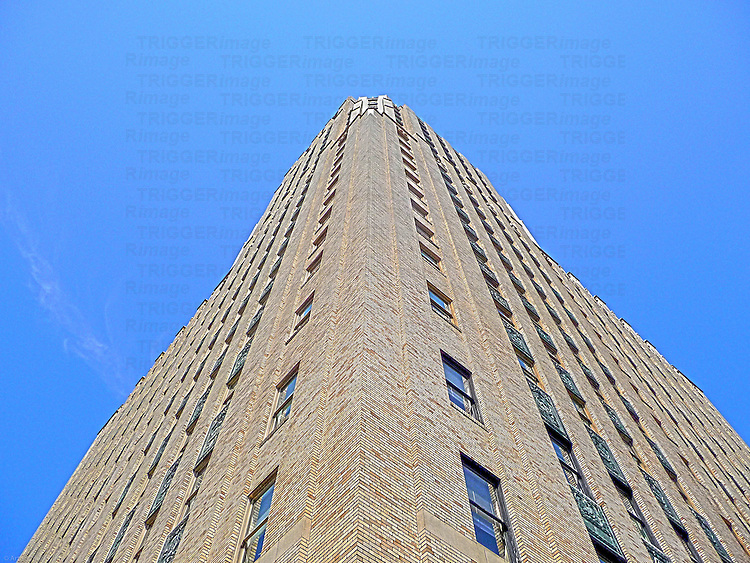 Tall modern building with blue sky looking up