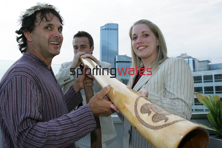 Rhys Williams playing a didgeridoo helped by aboriginal Ron Murray and Wales netball player Anna Mayes at the official reception to welcome Team Wales to Australia..Commonwealth Games.Melbourne Australia.12.03.06.©Steve Pope.Steve Pope Photography.The Manor .Coldra Woods.Newport.South Wales.NP18 1HQ.07798 830089.01633 410450.steve@sportingwales.com.