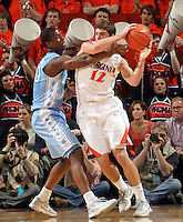 Virginia Cavaliers guard Joe Harris (12) is defended by North Carolina Tar Heels forward Harrison Barnes (40) during the game in Charlottesville, Va. North Carolina defeated Virginia 54-51.