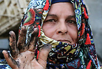 "A Palestinian woman Hadia Qudaih 70, makes a traditional eye cosmetic ""Arab kohl or Black eyeliner"" at her home in Khan Younis in the southern of Gaza strip, on February 17, 2020. Eye liner or eyeliner is a cosmetic used to define the eyes. It is applied around the contours of the eye(s) to create a variety of aesthetic effects. The history of cosmetics traverse from at least 7,000 years and is common in mostly every society. Photo by Mariam Dagga"