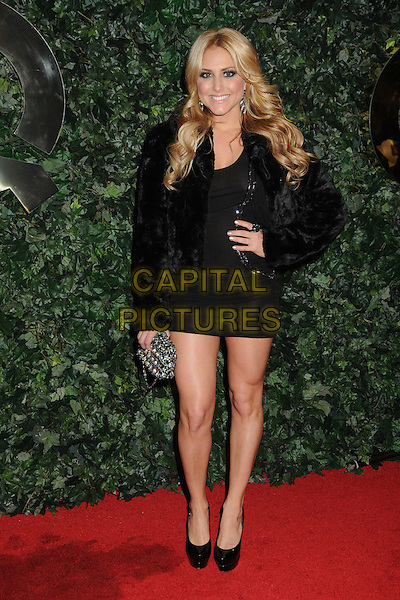 CASSIE SCERBO.QVC Red Carpet Style Party held at the Four Seasons Hotel, Beverly Hills, California, USA..February 25th, 2011.full length black tights silver dress clutch bag hand on hip  .CAP/ADM/BP.©Byron Purvis/AdMedia/Capital Pictures.