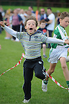 Ben Sweeney winning the boys under 9 race at O'Raghallaigh's fun day. Photo: Colin Bell/pressphotos.ie