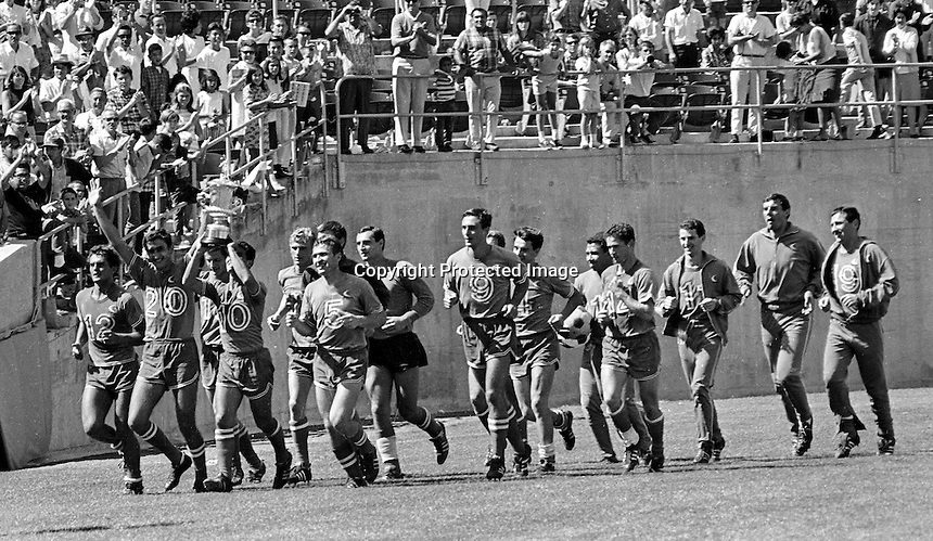 The Oakland Clippers professional soccer team takes a victory lap after winning the National Professional Soccer League in 1967. It was the first pro title for the city of Oakland. (photo/Ron Riesterer)