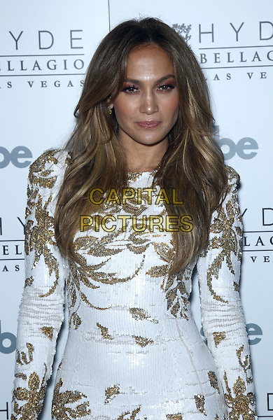 "Jennifer Lopez.Jennifer Lopez celebrates the release of new single ""Goin' In"" at Hyde Bellagio inside the Bellagio Resort & Casino, Las Vegas, Nevada,USA, .26th May 2012..half length white mini dress long sleeve gold sequined sequin .CAP/ADM/MJT.© MJT/AdMedia/Capital Pictures."