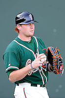 Catcher Chad Wallach (47) of the Greensboro Grasshoppers warms up before a game against the Greenville Drive on Wednesday, May 7, 2014, at Fluor Field at the West End in Greenville, South Carolina. Greenville won, 12-8. (Tom Priddy/Four Seam Images)