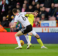 Blackburn Rovers' Joe Rothwell vies for possession with Sheffield United's Chris Basham<br /> <br /> Photographer Chris Vaughan/CameraSport<br /> <br /> The EFL Sky Bet Championship - Sheffield United v Blackburn Rovers - Saturday 29th December 2018 - Bramall Lane - Sheffield<br /> <br /> World Copyright © 2018 CameraSport. All rights reserved. 43 Linden Ave. Countesthorpe. Leicester. England. LE8 5PG - Tel: +44 (0) 116 277 4147 - admin@camerasport.com - www.camerasport.com