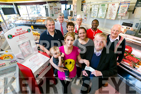 Bridget Moynihan from Camp, with son Jack receives her St Pat's lotto winning cheque for €4,900 from club treasurer Jim Savage at Seamus O'Sullivan butchers, Manor on Tuesday Pictured also  Eileen Counihan, Club President, Christy Murphy, Club Chairman Terry Boyle, Kathleen Poff,  Dan O'Sullivan, PRO, Dipo Dairo, and Mike Flynn